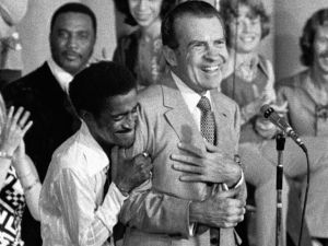 Entertainer Sammy Davis Jr. hugs President Richard Nixon at a youth rally in Miami, Aug. 22, 1972.