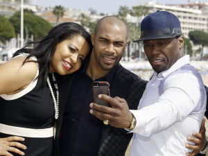 """Power showrunner Courtney Kemp Agboh poses for a selfie with executive producer Curtis """"50 Cent"""" Jackson and lead actor Omari Hardwick."""