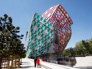 Foundation Louis Vuitton covered by a temporary artwork by French artist Daniel Buren titled Observatory of Light, Work in Situ.