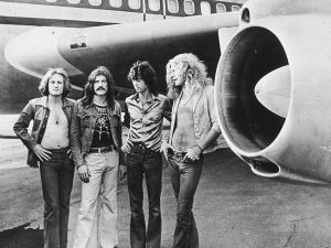 British rock band Led Zeppelin, (left - right): John Paul Jones, John Bonham (1948 - 1980), Jimmy Page and Robert Plant, pose in front of an their private airliner The Starship, 1973.