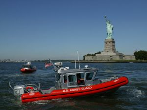 Coast Guard patrol boats motor past the the Statue of Liberty September 9, 2003 in New York City.