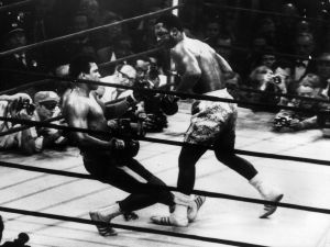March 1971: In a title fight at Madison Square Garden, New York, Muhammad Ali goes down in the 15th round to a left hook from world heavyweight champion Joe Frazier who kept the title with an unanimous points win.