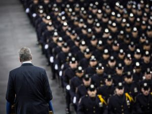 New York City Mayor Bill de Blasio speaks at the New York Police Department graduation ceremony at Madison Square Garden on December 29, 2014 in New York City.