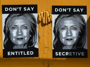 Anti-Hillary Clinton posters are seen on a sign post in Brooklyn on April 16, 2015, just blocks from Clintons new Brooklyn , New York 2016 presidential campaign headquarters . The posters feature illustrations of Clintons face along with slogans, including: Dont Say Secretive and Dont Say Entitled.