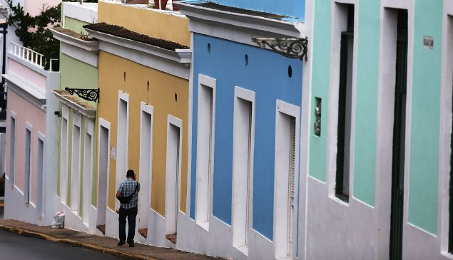 A pedestrian walks through a street in Old San Juan as the island's residents deal with the government's $72 billion debt on July 1, 2015 in San Juan, Puerto Rico. Governor of Puerto Rico Alejandro Garc?a Padilla said in a speech recently that the people of Puerto Rico will have to make sacrifices and share the responsibilities to help pull the island out of debt.