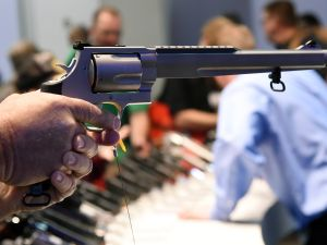 A convention attendee tries out a model S&W500 Magnum 10.5-inch barrel handgun at the Smith & Wesson booth at the 2016 National Shooting Sports Foundation's Shooting, Hunting, Outdoor Trade (SHOT) Show at the Sands Expo and Convention Center on January 19, 2016 in Las Vegas, Nevada. The SHOT Show, the world's largest annual trade show for shooting, hunting and law enforcement professionals, runs through January 23 and is expected to feature 1,600 exhibitors showing off their latest products and services to more than 62,000 attendees.