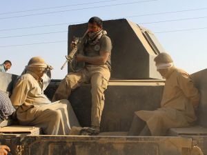 "Iraqi government and counter-terrorism forces arrest men suspected of belonging to the Islamic State (IS) jihadist group on March 10, 2016 following an operation to retake the town of Zankura, northwest of Ramadi, in Anbar province, from IS. Iraqi forces retook a town from the Islamic State jihadist group in Anbar province Thursday and evacuated 10,000 civilians as they advanced up the Euphrates valley, a security spokesman said. The sprawling province of Anbar -- which borders Syria, Jordan and Saudi Arabia -- was at the heart of the ""caliphate"" that IS proclaimed in 2014. The jihadist group still holds most of the province but the noose is tightening around some of its key bastions. / AFP / MOADH AL-DULAIMI"