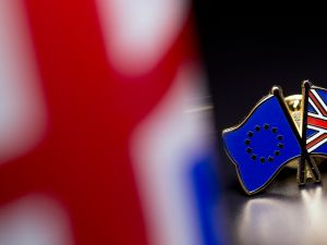 In this photo illustration, the European Union and the Union flag are pictured on a pin badge on March 17, 2016 in London, United Kingdom.