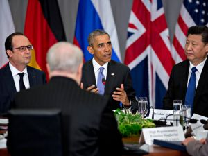 U.S. President Barack Obama (C) speaks as Xi Jinping, China's president (R), and Francois Hollande, France's president (L), listen during a P5+1 multilateral meeting at the Nuclear Security Summit on April 1, 2016 in Washington, D.C. After a spate of terrorist attacks from Europe to Africa.