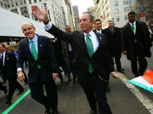 Former New York City Mayor Rudy Giuliani (L) and current New York City Mayor Michael Bloomberg wave to the crowd during the St. Patrick's Day Parade March 17, 2005 in New York.