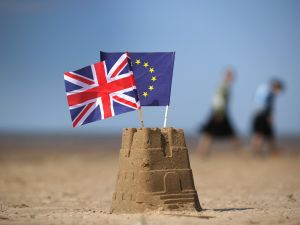 In this photo illustration the flag of the European Union and the Union flag sit on top of a sand castle on a beach on May 09, 2016 in Southport, United Kingdom.
