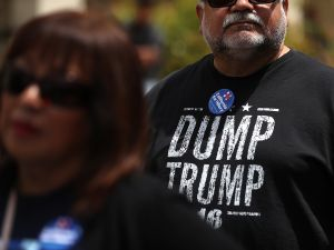 """SALINAS, CA - MAY 25: A supporter of democratic presidential candidate former Secretary of State Hillary Clinton wears a """"Dump Trump"""" shirt before a campaign rally at Harrell College on May 25, 2016 in Riverside, California. Hillary Clinton is campaigning in California ahaed of the State's presidential primary on June 7th."""