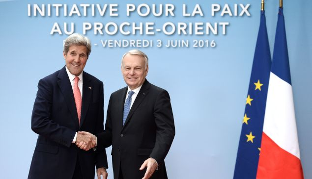 French Foreign minister Jean-Marc Ayrault (R) shakes hands with US Secretary of State John Kerry upon his arrival for an international and interministerial meeting in a bid to revive the Israeli-Palestinian peace process, in Paris, on June 3, 2016. France will host talks on the Israeli-Palestinian conflict that have received a chilly response from Washington, but diplomats say merely swinging the spotlight back onto the stalemate is a victory. Instead representatives of some 25 countries, as well as the United Nations, European Union and Arab League, will try and lay the ground for a fully-fledged peace conference to be held by the end of the year.