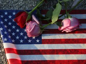 Flowers and an American flag are seen on the ground near the Pulse Nightclub where Omar Mateen allegedly killed at least 50 people on June 13, 2016 in Orlando, Florida.