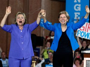 CINCINNATI, OH- JUNE 27: Democratic Presidential candidate Hillary Clinton (L) and U.S. Sen Elizabeth Warren (D-MA) (R) wave to the crowd before a campaign rally at the Cincinnati Museum Center at Union Terminal June 27, 2016 in Cincinnati, Ohio. Warren is helping Clinton campaign in Ohio.