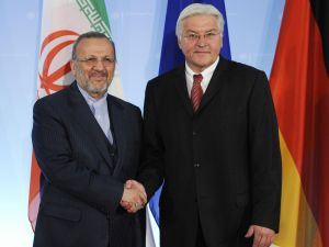 German Foreign Minister Frank-Walter Steinmeier (R) greets Iranian Foreign Minister Manouchehr Mottaki prior to talks on Tehran's disputed nuclear programme at the foreign ministry in Berlin September 15, 2008. The Berlin talks are part of a series of meetings between the European Union and Iran over Tehran's nuclear work and were initiated by Mottaki. AFP PHOTO JOHN MACDOUGALL
