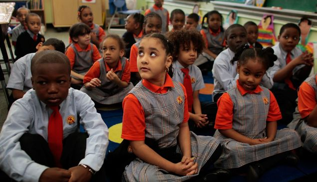 Students wait for their teacher at Harlem Success Academy, a free, public elementary charter school.