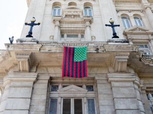 A David Hammons flag piece hanging on the Museo Nacional de Bellas Artes in Havana, Cuba.
