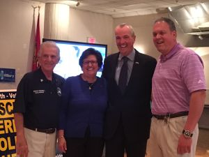 Murphy (second from right) at a Democratic State Committee event in Little Falls.