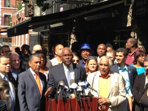 Assemblyman Keith Wright, center, flanked by State Senator Adriano Espaillat and Congressman Charles Rangel.