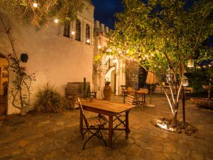 """Restored in 1989, Dar Marroc was renamed Korakia (Greek for """"crow"""") and crafted into a Mediterranean-style resort. The resort, now housed in two lovingly restored historic villas, rests on 1.5 lush acres, consisting of bungalows, guesthouses, gardens and pools."""