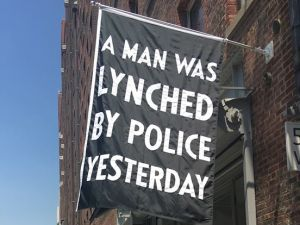 Dread Scott, A Man Was Lynched By Police Yesterday. The work is installed outside Jack Shainman Gallery on West 20th Street in Manhattan.