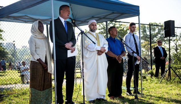 Mayor Bill de Blasio and First Lady Chirlane McCray speak at an Eid al-Fitr prayer at Bensonhurst Park in Brooklyn.