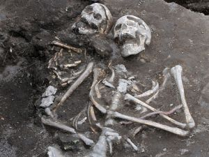 Archaelogists inspects a grave with a skeleton with an iron rod penetrated the heart body area, dated back in the Middle Ages in the ancient Thracian temple of Perperikon south east of the Bulgarian capital Sofia, Thursday, Oct. 09, 2014. Bulgarian archaeologist Nikolai Ovcharov who discovered the grave says have unearthed centuries-old skeletons pinned down through their chests with iron rods - a practice believed to stop the dead or killed from becoming vampires. Those are the sixth and seventh vampire graves discovered in the country for the past two years.