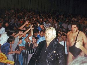 """Bobby """"The Brain"""" Heenan leads Andre the Giant to the ring for a WWF bout."""