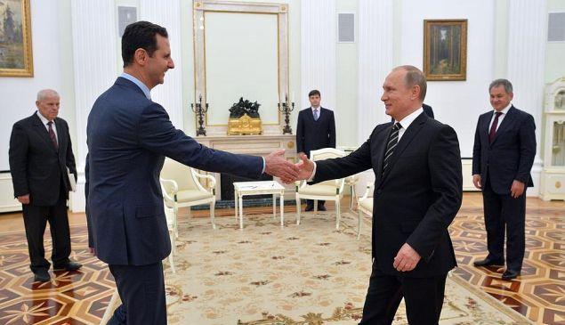 Bashar Assad greets Vladimir Putin.