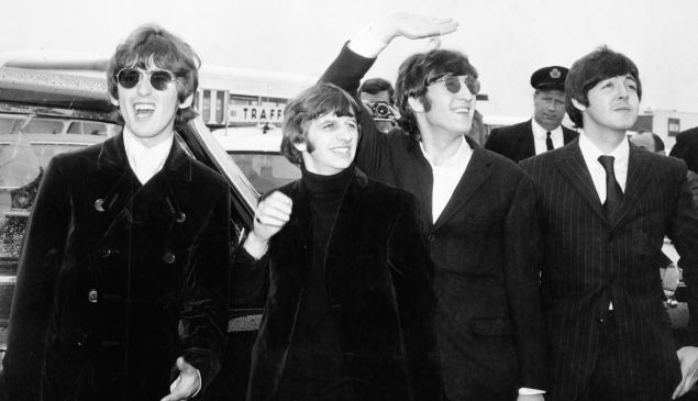 Pop group The Beatles, waving to screaming fans en route to Boston airport, America, from left to right, George Harrison, Ringo Starr, John Lennon and Paul McCartney, on August 12, 1966.