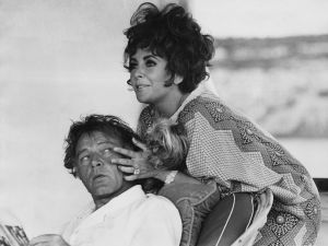 Richard Burton and Elizabeth Taylor, just relaxing on their yacht off the coast of Capo Caccia in Sardinia.