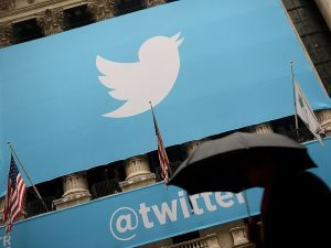 A banner with the logo of Twitter is set on the front of the New York Stock Exchange (NYSE) on November 7, 2013 in New York. Twitter hit Wall Street with a bang on Thursday, as an investor frenzy quickly sent shares surging after the public share offering for the fast-growing social network. In the first exchanges, Twitter vaulted 80.7 percent to $47, a day after the initial public offering (IPO) at $26 per share. While some analysts cautioned about the fast-changing nature of social media, the debut led to a stampede for Twitter shares. AFP PHOTO/EMMANUEL DUNAND (Photo credit should read EMMANUEL DUNAND/AFP/Getty Images)