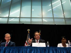 Gov. Andrew Cuomo, center, with Attorney General Eric Schneiderman, left.