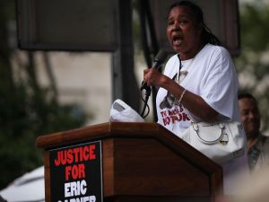 Esaw Garner, widow of Eric Garner, speaks at a rally in Brooklyn one year ago on the one-year anniversary of her husband's death