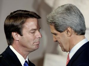 BOSTON, UNITED STATES: Former Democratic presidential candidate John Kerry(R) stands with running mate John Edwards at his concession speech in Faneuil Hall 03 November 2004 in Boston, Massachusetts. Kerry phoned US President George W. Bush at the White House earlier 03 November to concede the US presidential election. AFP PHOTO/ JEFF HAYNES