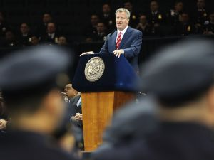 New York City Mayor Bill de Blasio speaks to new members of New York City's police department's graduating class during a swearing in ceremony at Madison Square Garden on July 1, 2016 in New York City.