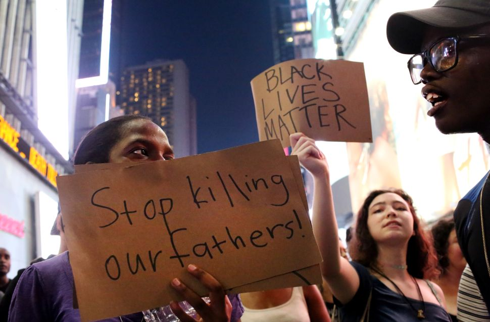 21 Powerful Photos From Police Brutality Protests for Alton Sterling, Philando Castile