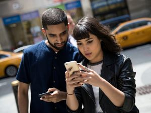 NEW YORK, NY - JULY 11: (L to R) Sameer Uddin and Michelle Macias play Pokemon Go on their smartphones outside of Nintendo's flagship store, July 11, 2016 in New York City. The success of Nintendo's new smartphone game, Pokemon Go, has sent shares of Nintendo soaring.
