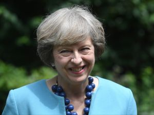 """British Prime Minister Theresa May hosts a reception for the Police Bravery Award in the garden of 10 Downing Street in central London on July 14, 2016. Britain's new Prime Minister Theresa May showed several of her former cabinet colleagues the door Thursday, including top Brexit campaigner Michael Gove, while fellow """"Leave"""" supporter Boris Johnson was crowned top diplomat. / AFP / POOL / Andrew Parsons"""
