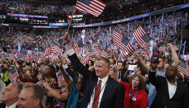 New York City Mayor Bill de Blasio cheers with delegates at the end of the fourth day of the Democratic National Convention