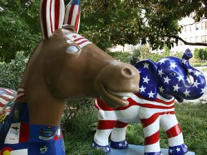 The symbols of the Democratic(L) (donkey) and Republican (elephant) parties are seen on display in Washington, DC on August 25, 2008.