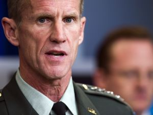"""US commander in Afghanistan General Stanley McChrystal (R) speaks during a press briefing with White House spokesman Robert Gibbs (rear) and US Ambassador to Afghanistan Karl Eikenberry (not seen)at the White House in Washington, DC, May 10, 2010. McChrystal, the top NATO commander in Afghanistan, on Monday predicted """"increased violence"""" in the country but said President Barack Obama's surge strategy would ultimately succeed. AFP PHOTO/Jim WATSON"""