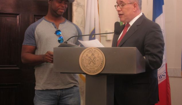 Comptroller Scott Stringer presents a $50,000 check to Bronx resident Wilson Lopez.