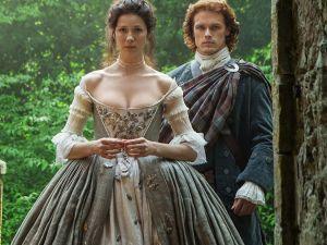 Caitriona Balfe as Claire Randall and Sam Heughan as Jamie Fraser on Outlander.