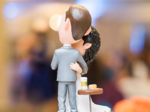 A coffee meets bagel wedding cake topper for a couple who met on the app.