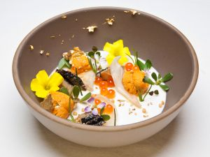 The Ugly Bunch, one of Providence's most famous dishes, is a symphony of abalone, geoduck, sea urchin and smoked creme fraiche panna cotta adorned with edible flowers from the restaurant's roof garden.