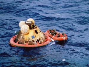 Apollo 11 crewmen await pickup by helicopter following splashdown on July 24, 1969.
