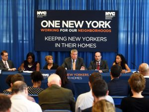 Mayor Bill de Blasio makes an announcement regarding legal representation for tenants in housing court at the High Bridge Library in the Bronx, New York.