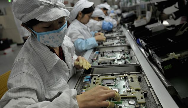 In a picture taken on May 26, 2010 Chinese workers assemble electronic components at the Taiwanese technology giant Foxconn's factory in Shenzhen. Foxconn on June 2 confirmed the death of another employee but denied he died of exhaustion following a spate of suicides at its Chinese plants.